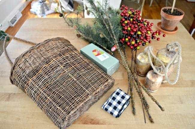 Create a simple DIY Christmas front door basket, with just a few supplies, to add holiday color to your front door.