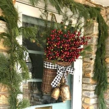 front door decorated for Christmas with greenery