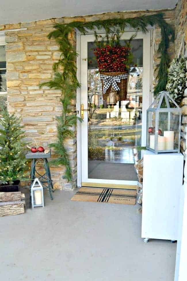 Rustic Christmas front porch ideas to help you decorate your outdoor space for the holidays.