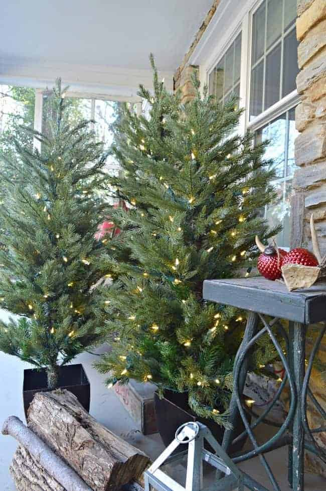 christmas front porch trees and twig table