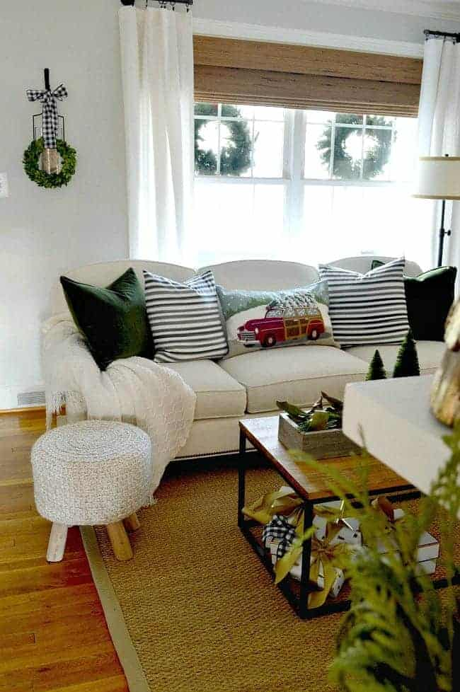 Sharing our cottage Christmas decor in this tour of the living room, plus a few easy Christmas decorating tips.