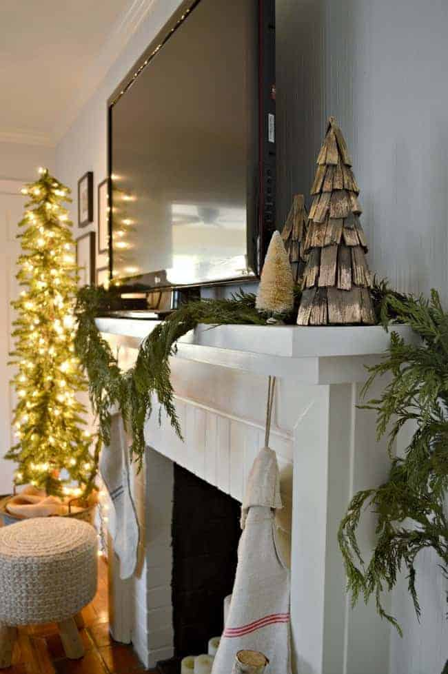 Sharing our cottage Christmas decor in this tour of a small living room, plus a few easy Christmas fireplace decorating tips.