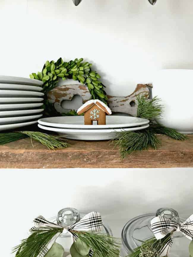 How to create a cozy cottage Christmas kitchen by using farmhouse touches like fresh greenery from the yard.