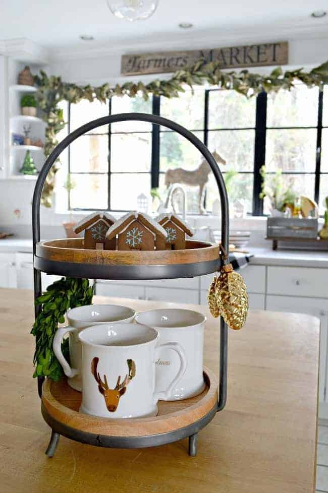 How to create a cozy cottage Christmas kitchen by using farmhouse touches like a two tiered tray and gingerbread houses.