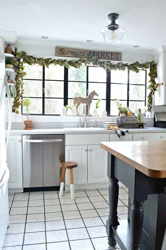 A cozy cottage Christmas kitchen with tons of farmhouse decorating ideas.