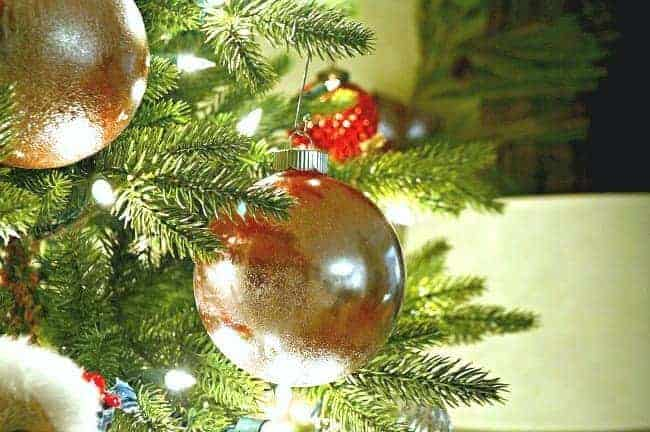 12 easy Christmas tree ideas to try including this DIY mercury glass ornament.