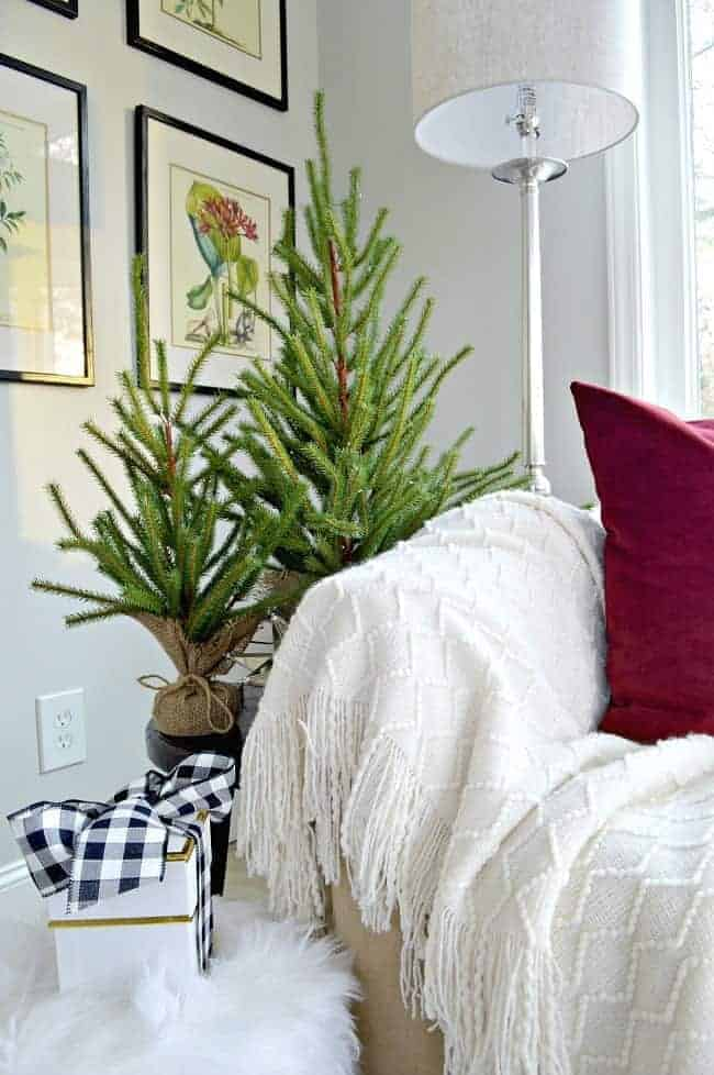 Sharing cottage Christmas decor in this tour of a sunroom, plus a few easy Christmas decorating tips.