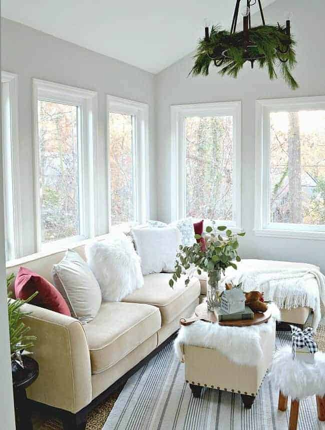 Sharing pretty cottage Christmas decor in this tour of a small but inviting sunroom, plus a few easy Christmas decorating tips and tricks.