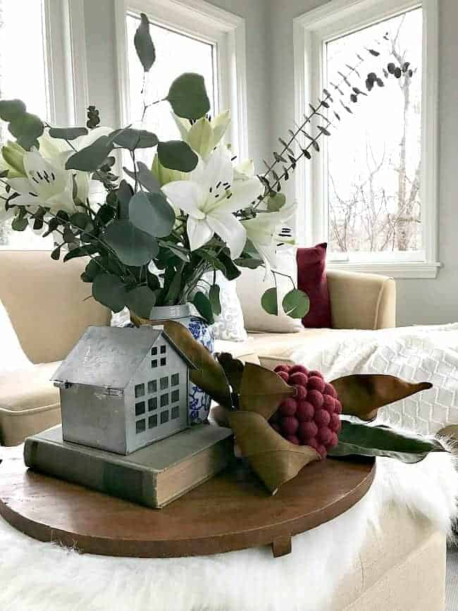 Sharing cottage Christmas decor in this tour of a small but bright sunroom, plus a few easy Christmas decorating tips.