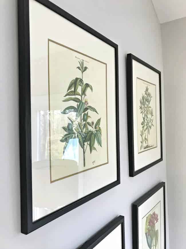 Thrifty ideas for decorating a sunroom using $10 thrifted art and paint for a plain door.