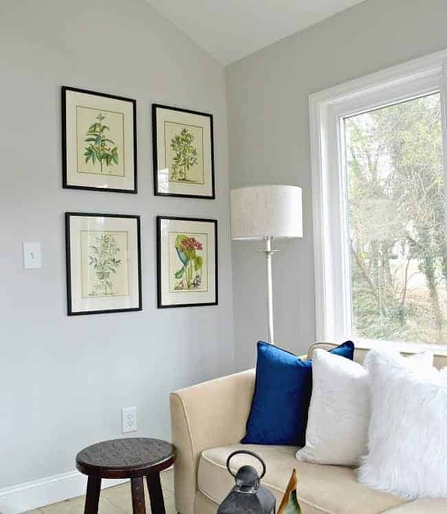 Thrifty ideas for decorating a sunroom using $10 thrifted artwork and paint for a plain white door.