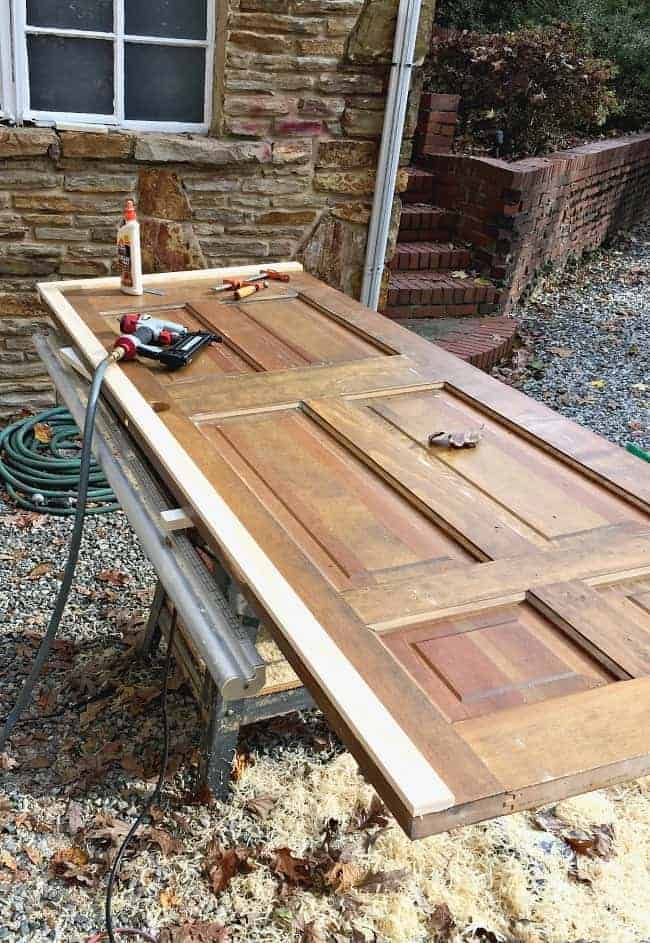 adding wood to beef up an old wood door