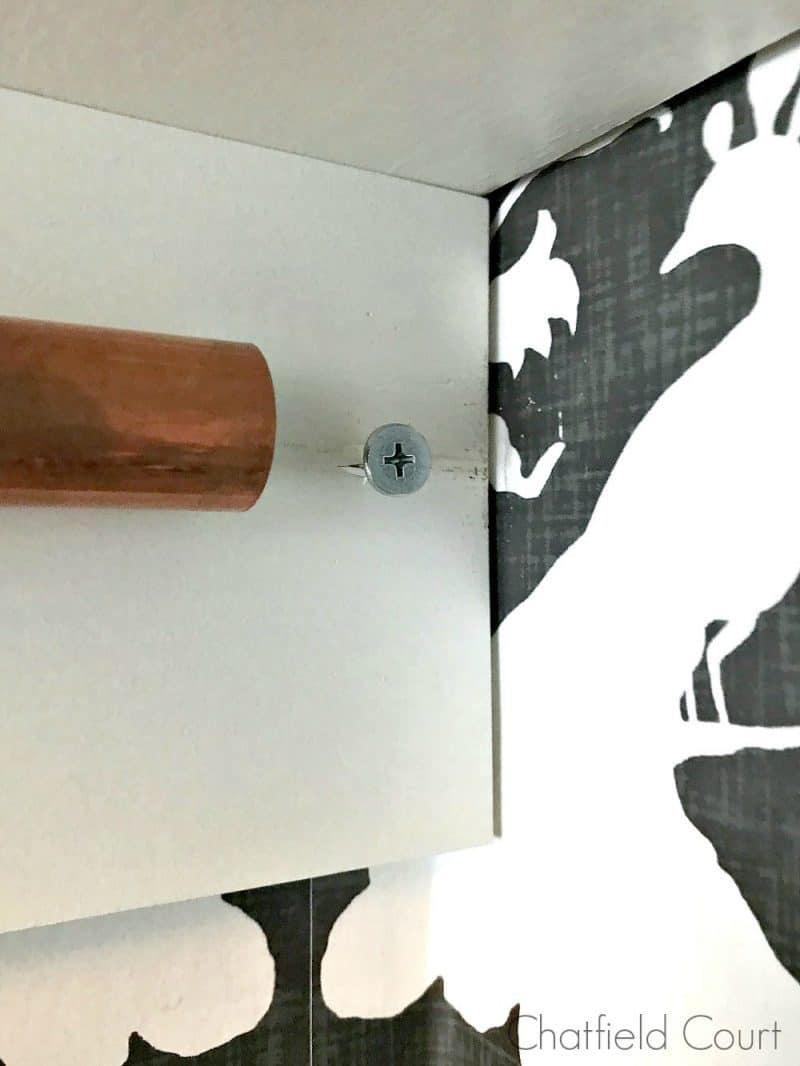 screw in wood board by copper pipe