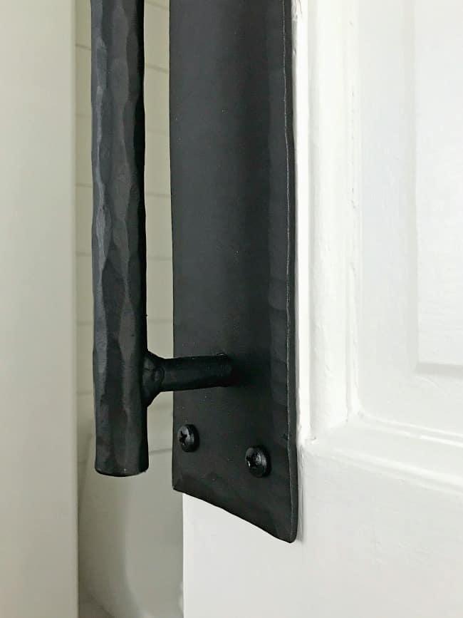 iron handle on white door