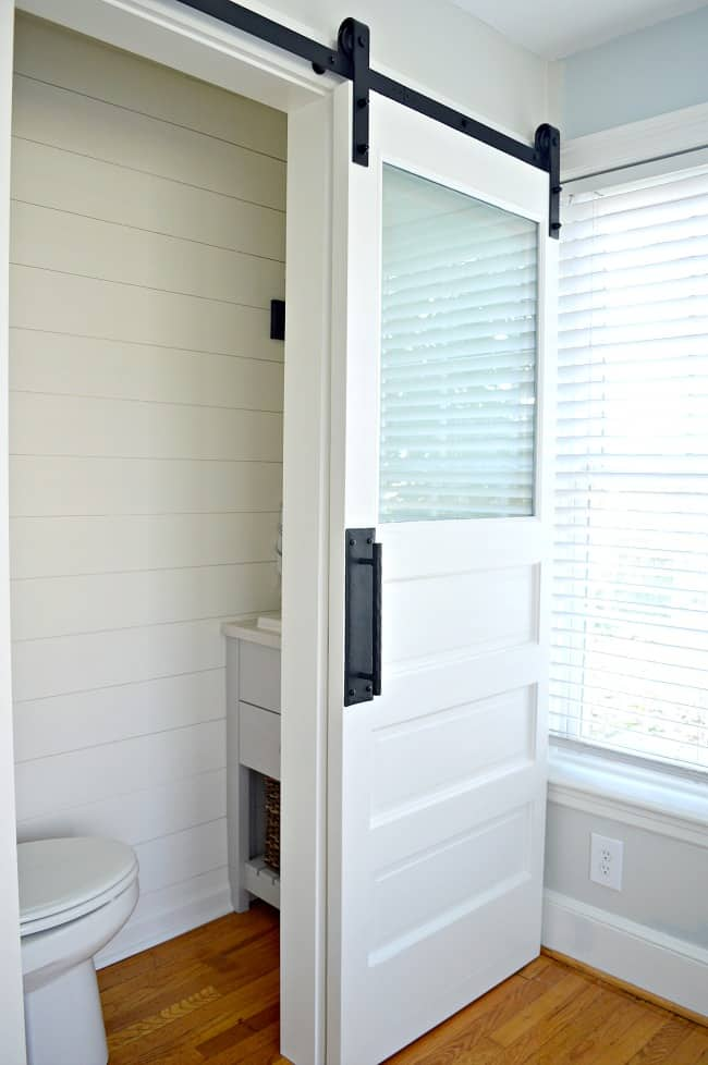 small powder room with a white painted barn door with frosted glass window - Frosted Glass Barn Door