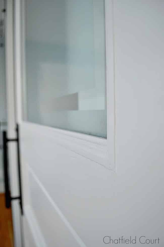 frosted glass door on barn door for powder room
