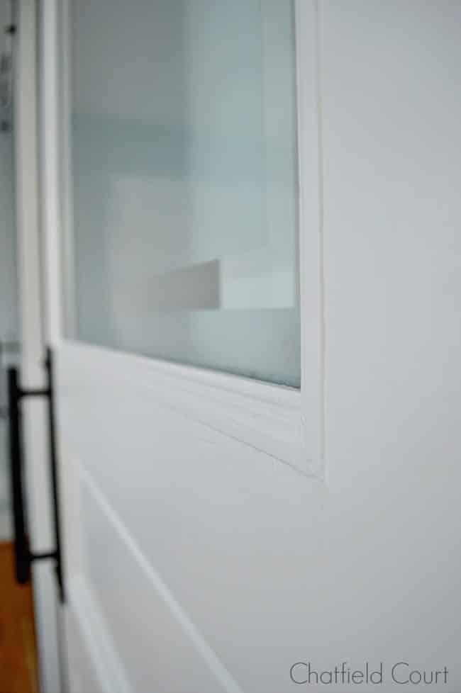 frosted glass door on barn door for powder room
