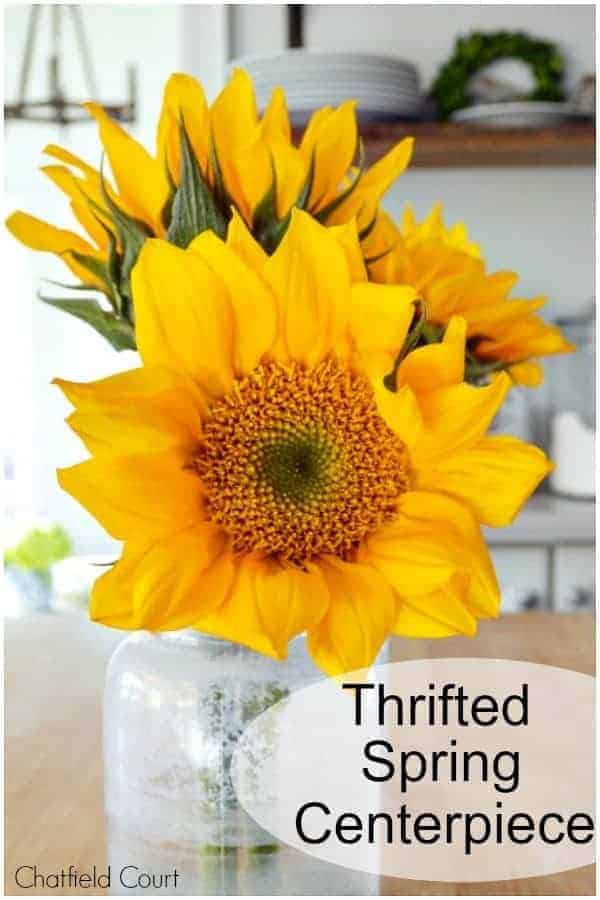 large sunflowers in glass bottle