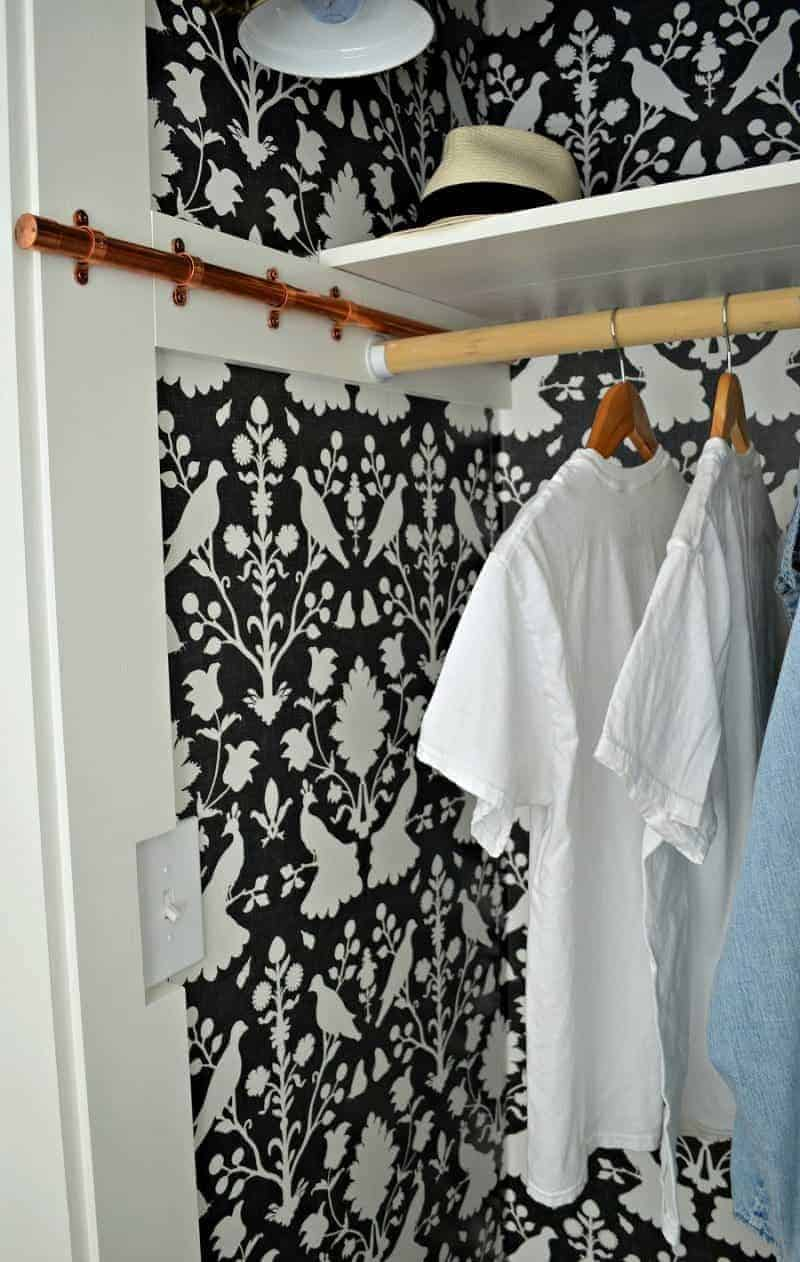 DIY copper pipe sliding clothes rod in a closet