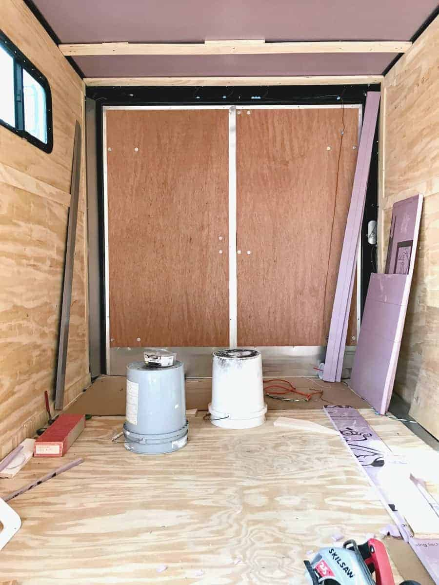 rear doors in a landscape trailer and insulation and wood supports in ceiling