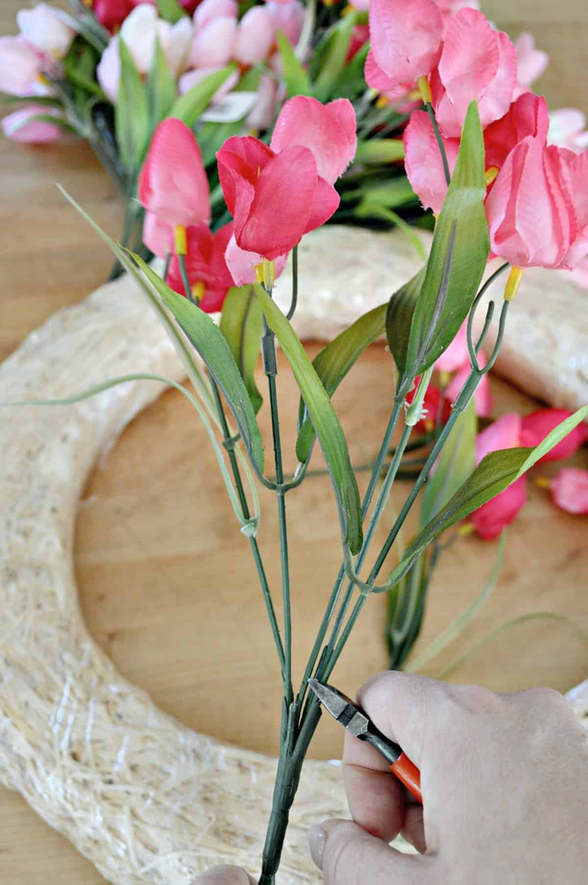 snipping faux pink tulips with nippers