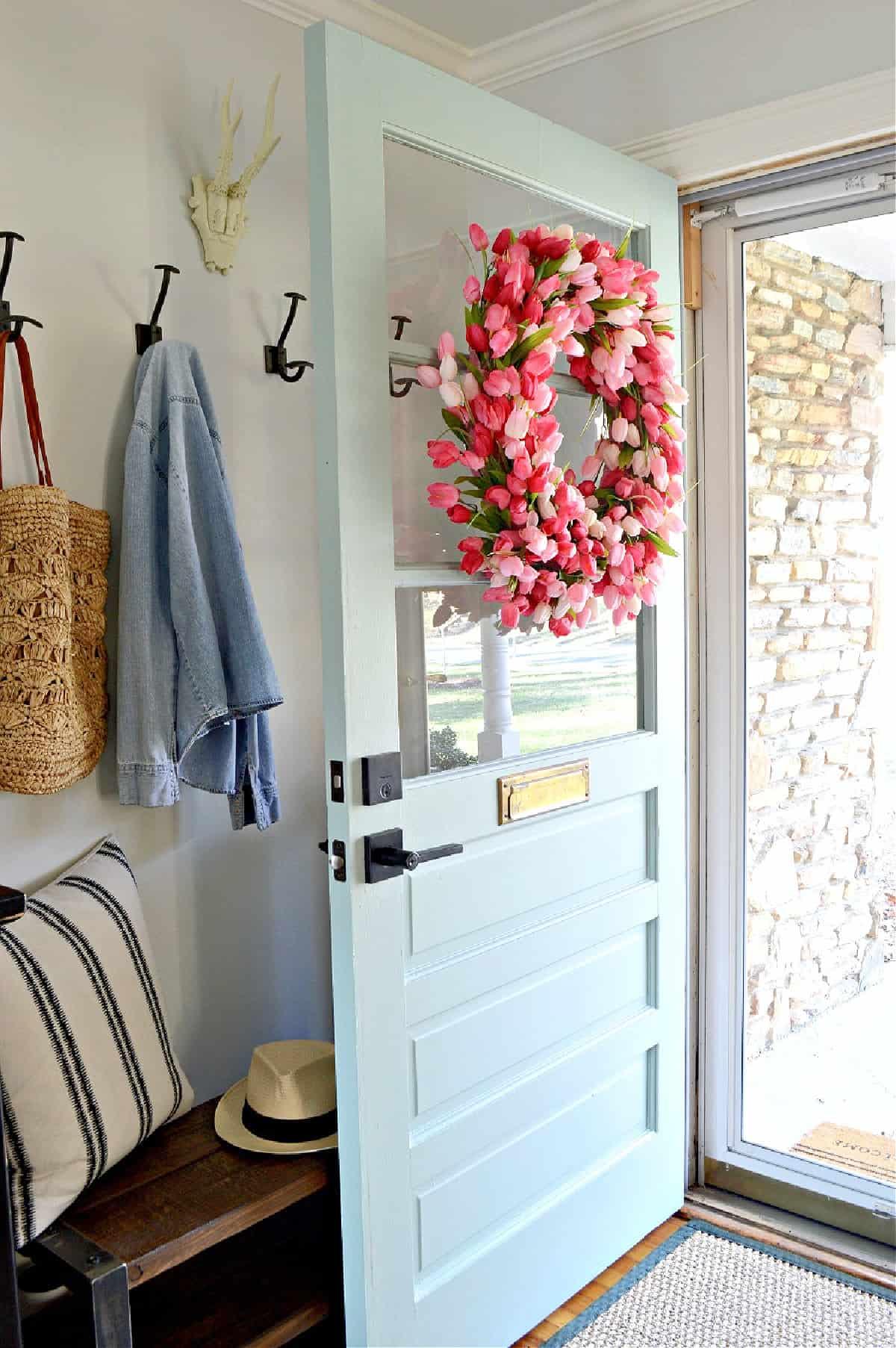 pink tulip wreath on blue front door