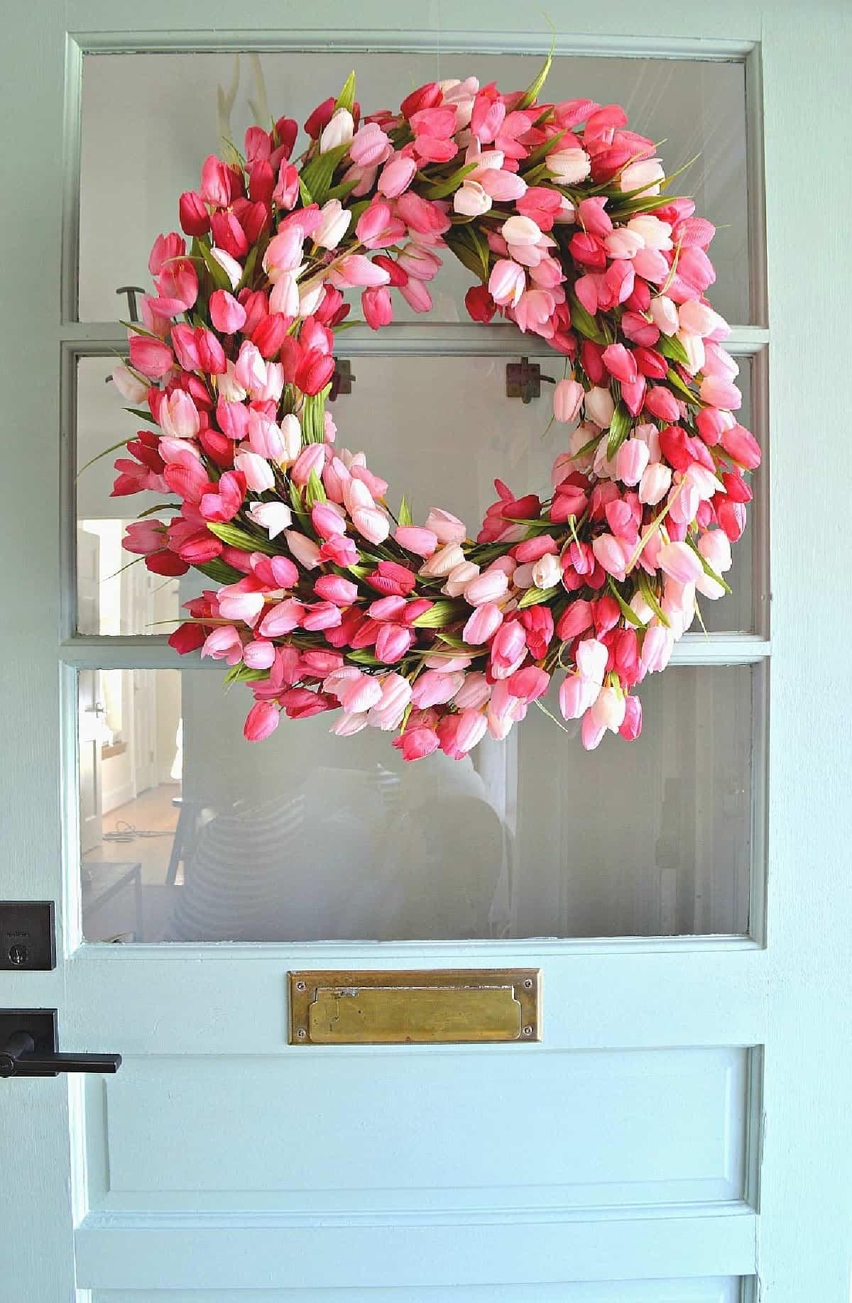 A tulip wreath on a front door