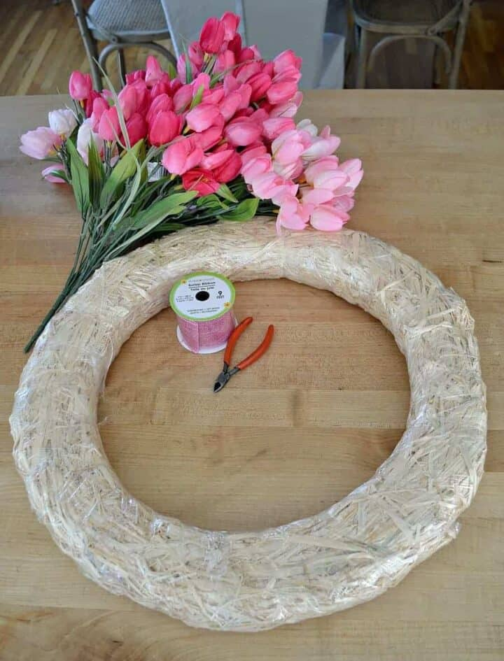 Supplies to make tulip wreath. Tulips, ribbon, wreath form and wire cutters.