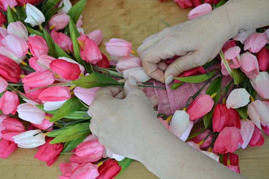 adding pink tulips to a DIY tulip wreath