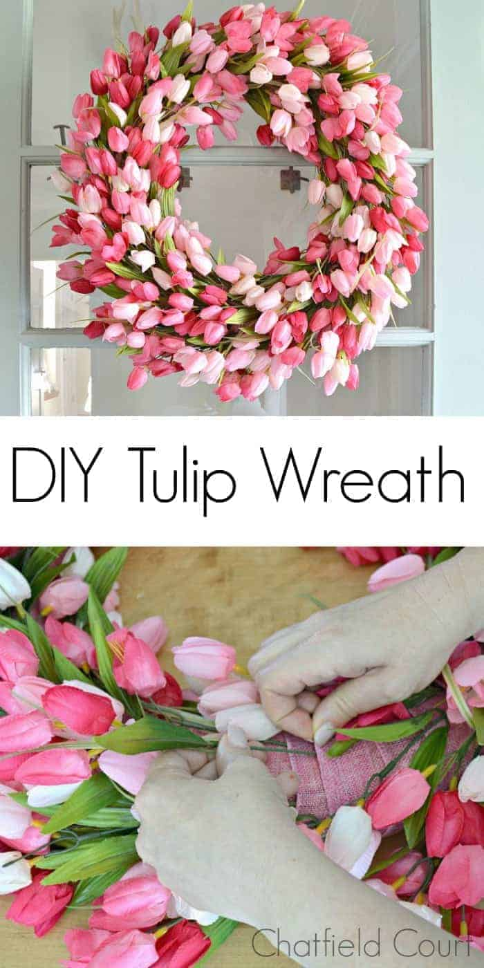 pink tulip wreath hanging on a blue front door