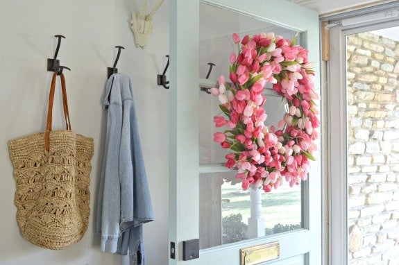 tulip wreath hanging on farmhouse front door