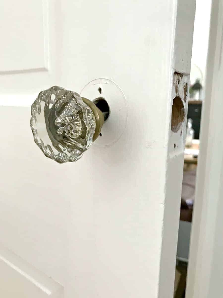 Vintage Glass Door Knob Hanging Loosely On Door
