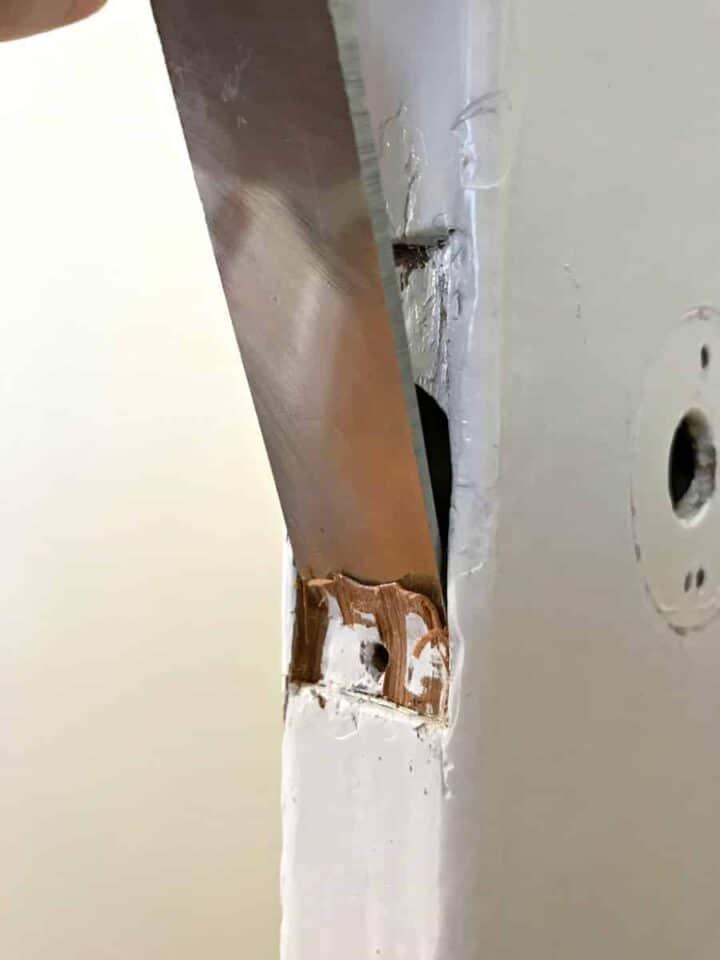 chiseling an old wood door for a new door knob