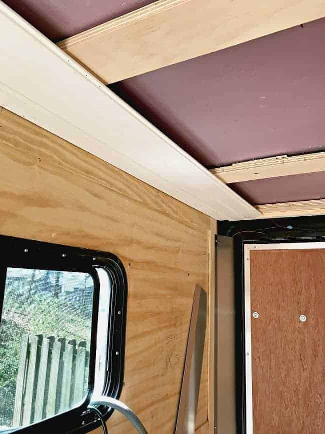 installing planks in ceiling for our RV renovation