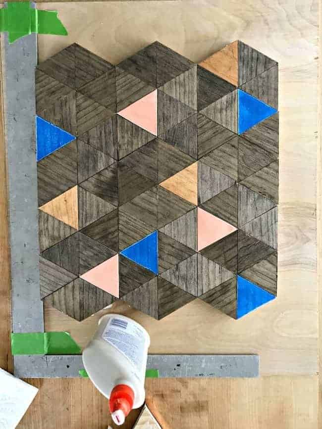 wood triangles getting glued onto underlayment