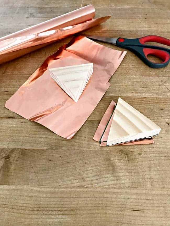 copper sheet and wood triangles