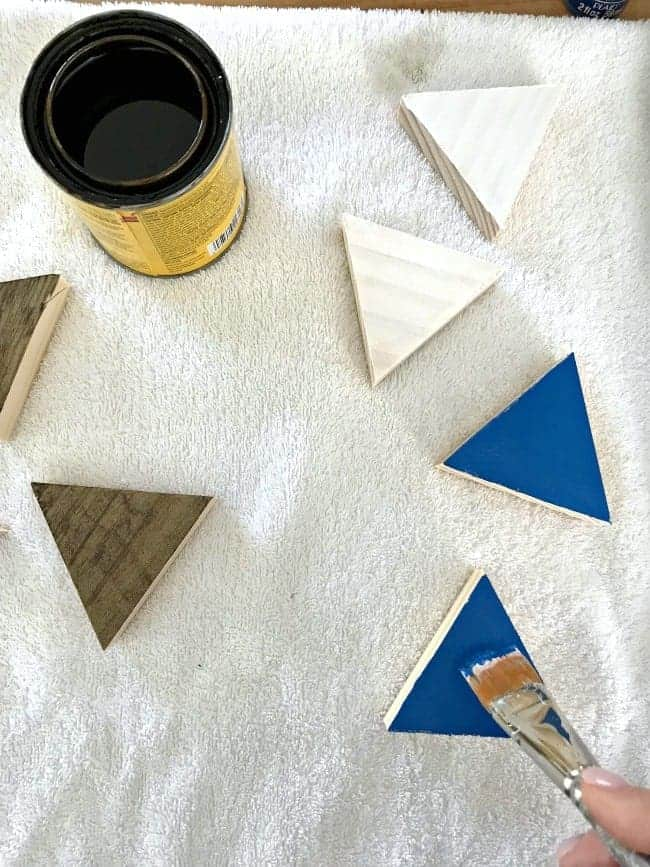 painted and stained wood triangles