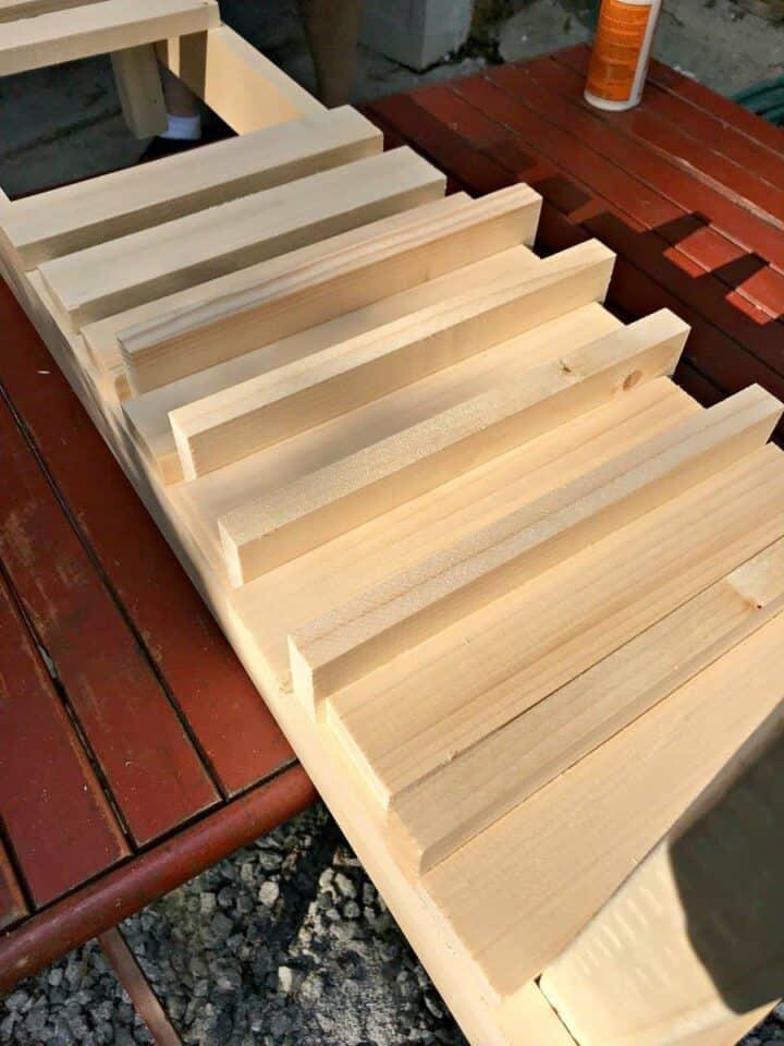 attaching slats on shelf of DIY wood planter