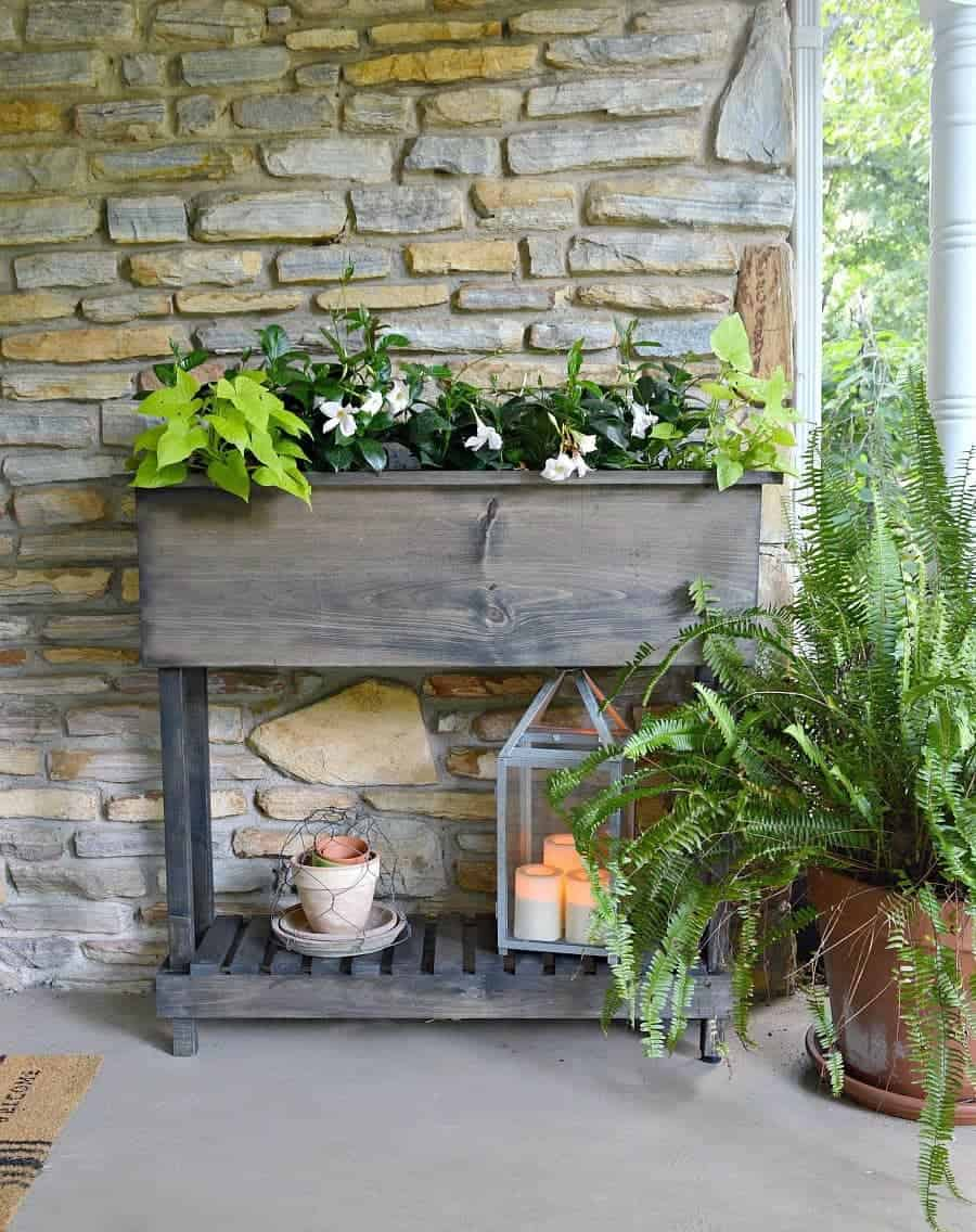 DIY wood planter on front porch of stone cottage