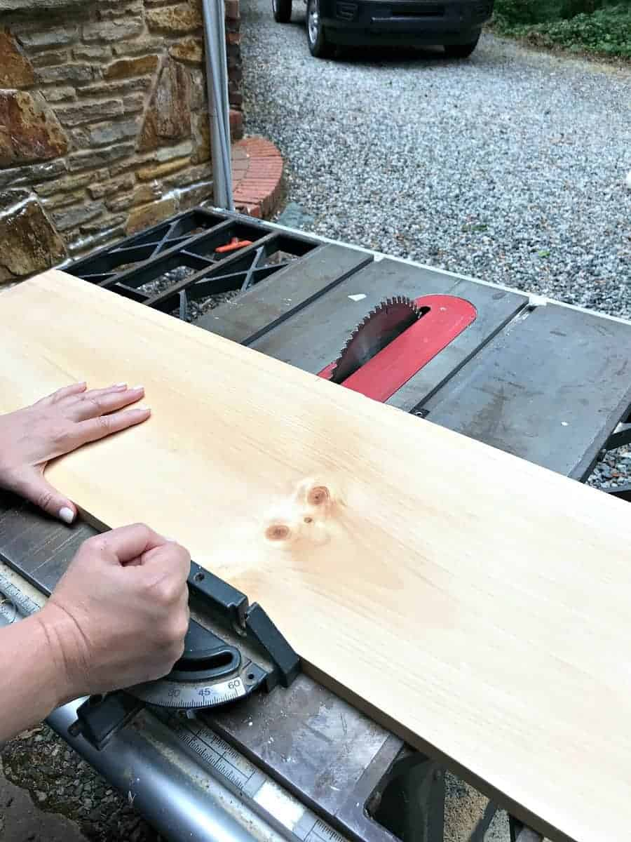 cutting 8' pine board on table saw for DIY wood planter