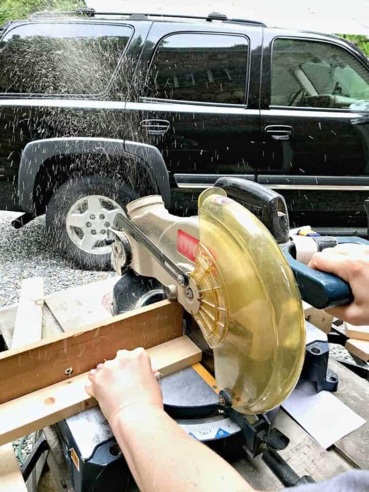 cutting slats for DIY wood planter on chop saw