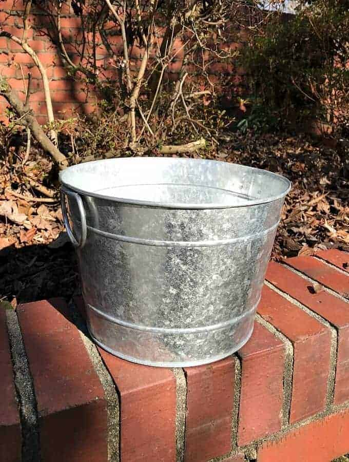 galvanized bucket used to make a DIY succulent planter