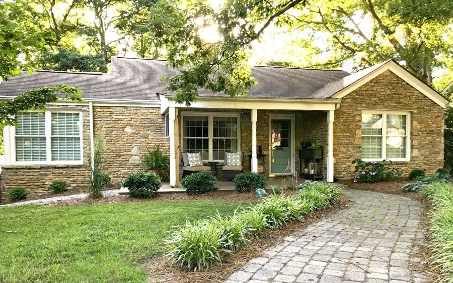 cottage musings for June 2018 and stone cottage ranch with covered front porch and brick walkway