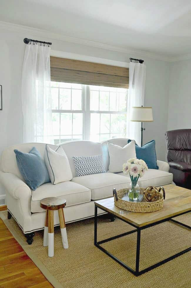 white living room sofa in front of big window