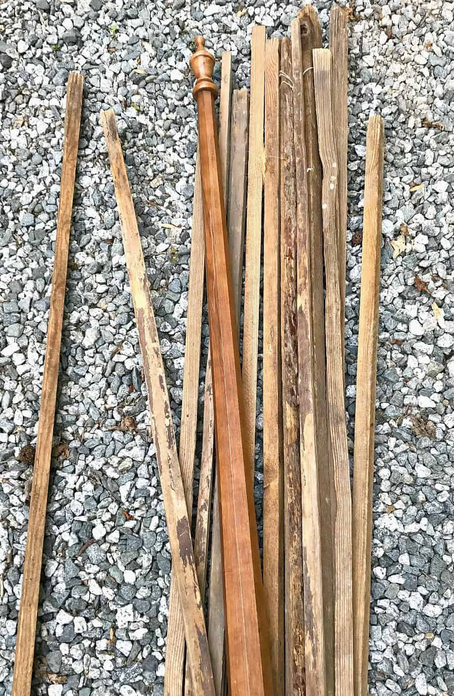 scrap wood tobacco sticks laying on the stone driveway