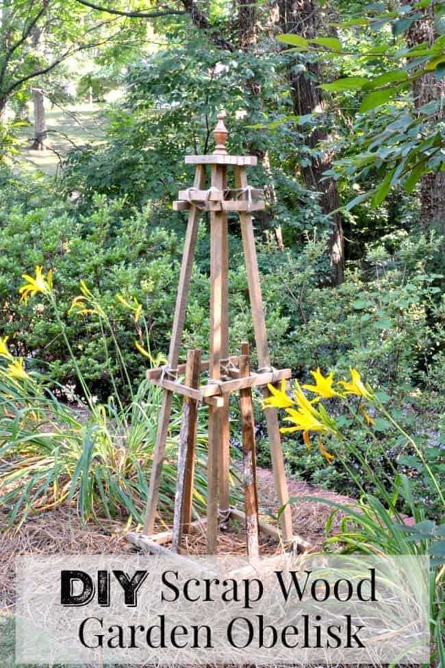a DIY wooden garden obelisk in a garden with orange daylilies