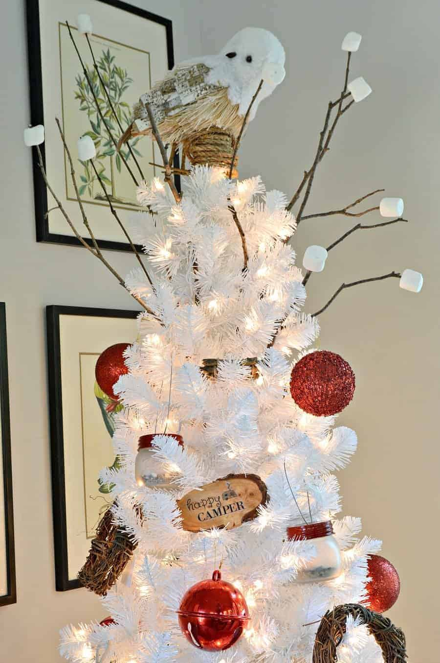 white Christmas tree decorated in a camping theme with DIY mason jar lanterns