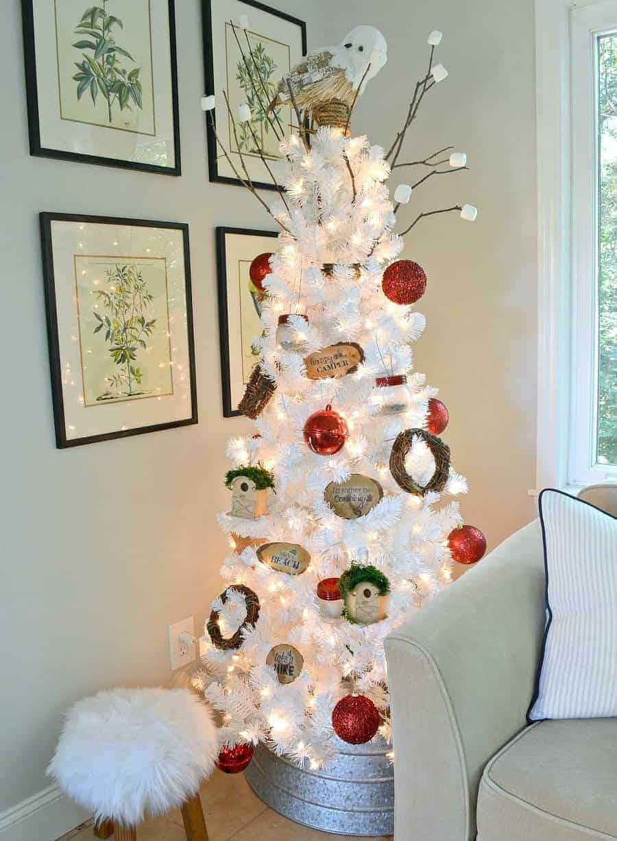 white Christmas tree decorated in a camping in the mountains theme with DIY mason jar lanterns