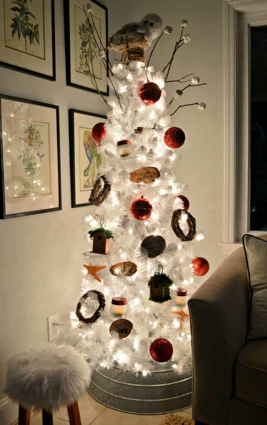 white Christmas tree at night decorated in a camping in the mountains theme with DIY mason jar lanterns