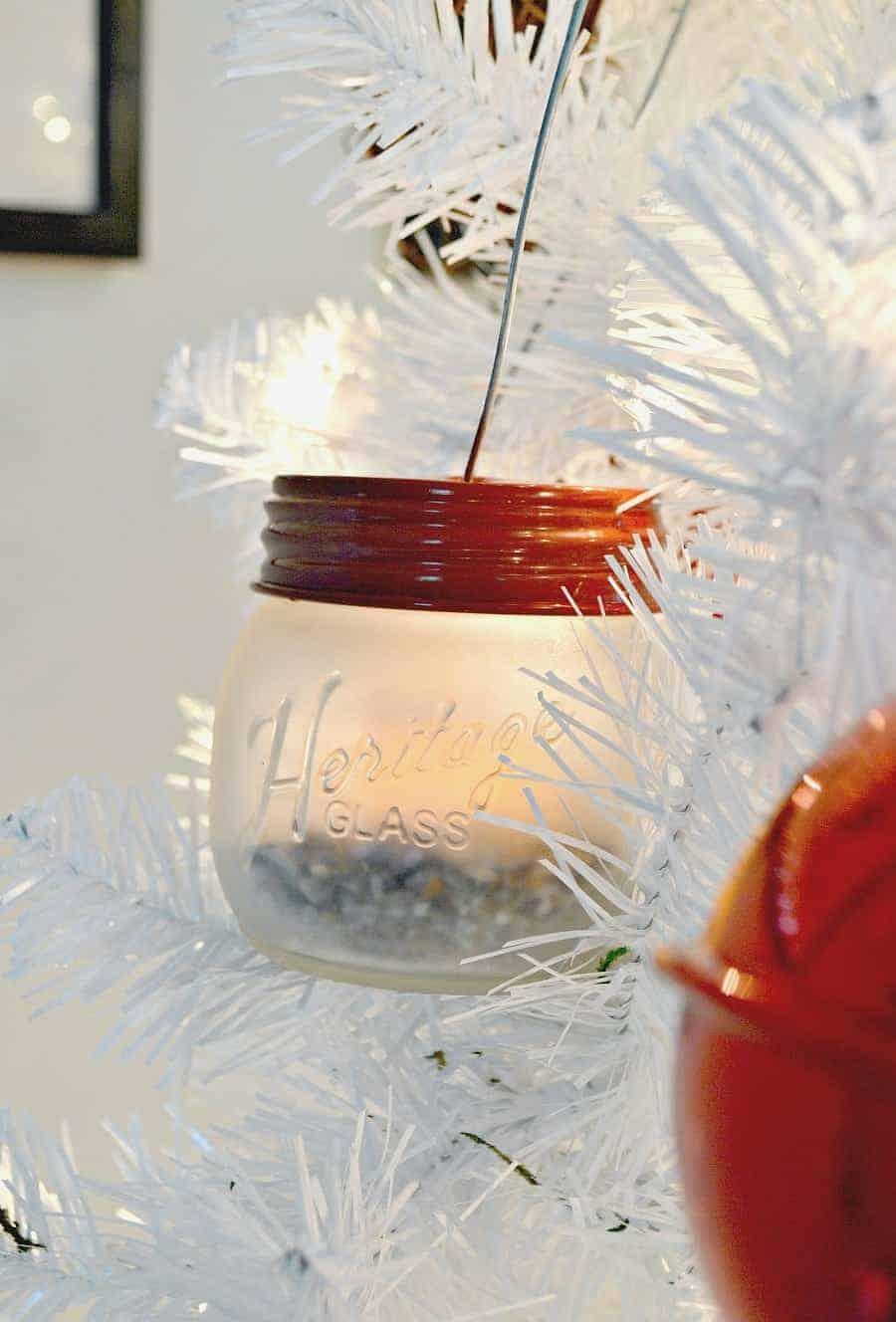 mini DIY mason jar lanterns hanging in white Christmas tree